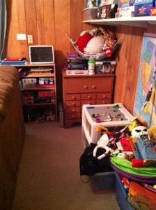 Use an old dresser and bookshelf for playroom storage
